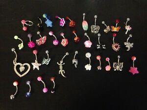 34 belly button rings (never used)
