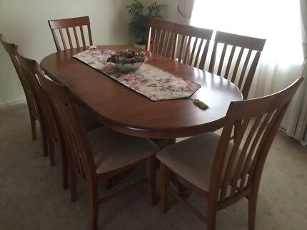 Extendable Formal Dining Table With Eight Chairs