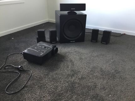 Home theatre system with projector and surround sound