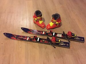 Kids size 9 ski boots and 80cm skis