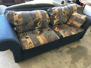 Couch with reversible cushions