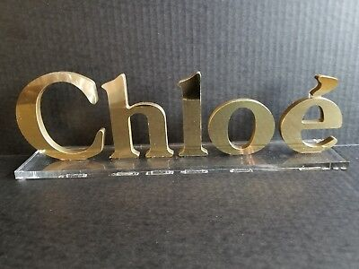 Chloe Logo Display Sign Gold Colored Mirrored Chloe Letters With Clear Bottom
