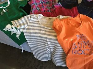Assortment of maternity clothes