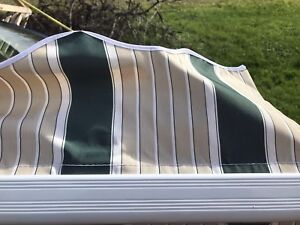 AWNING- ROLL OUT 12' x 10'.    BRAND NEW!