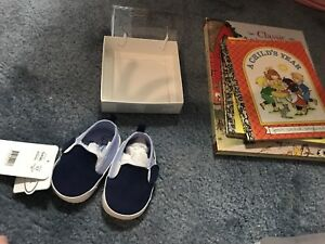 Baby books and new baby shoes