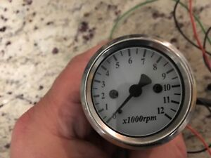 Mini motorcycle tach stainless.