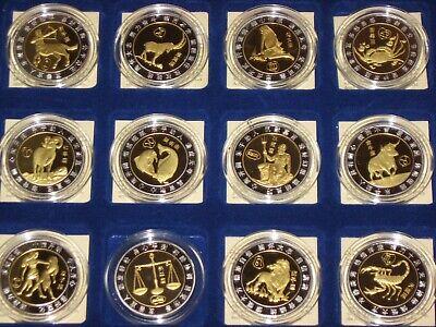 BTN/Münzen/Geld/Kapsel/Sternzeichen/Horoskop/Steinbock/Fisch/Jungfrau/China/ - Junge Münze
