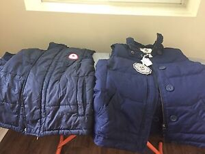 Two blue puffy vests brand new