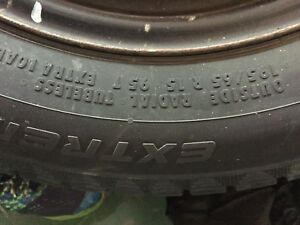 Set of 4 continental extreme snow tires with rims.