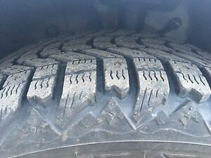 4 studded Firestone Winterforce tires on rims