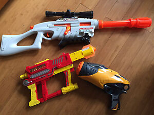 Various nerf guns and bag of bullets