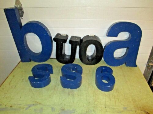 Vintage advertising tin letters