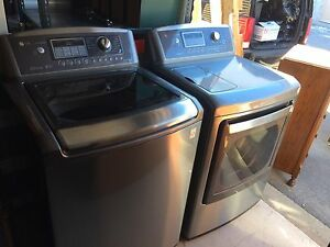 LG  STAINLESS WASHER AND DRYER WITH STEAM DRY OPTION