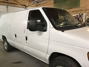 2007 ford e250 cargo van and 2006 ford freestar