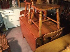 Solid maple drop leaf table /four matching chairs $425 or bo