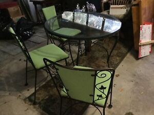 Iron and glass table and chairs