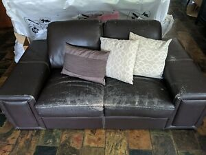 Brown bonded leather couches