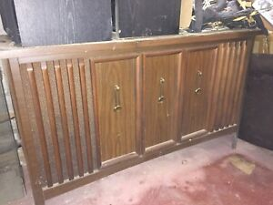 Antique Record player and radio cabinet.