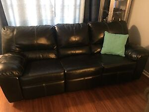 Black leatherette couch and love seat