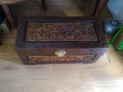Trunk,85cm long,40wide,35 deep,carved country scenes all over.