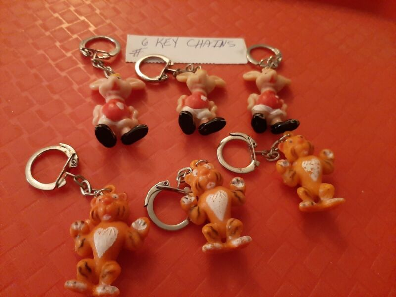 VINTAGE GUMBALL/DIME STORE TONY TIGER AND TOPPIO GIGGLIO KEY CHAIN CHARMLOT OF 6