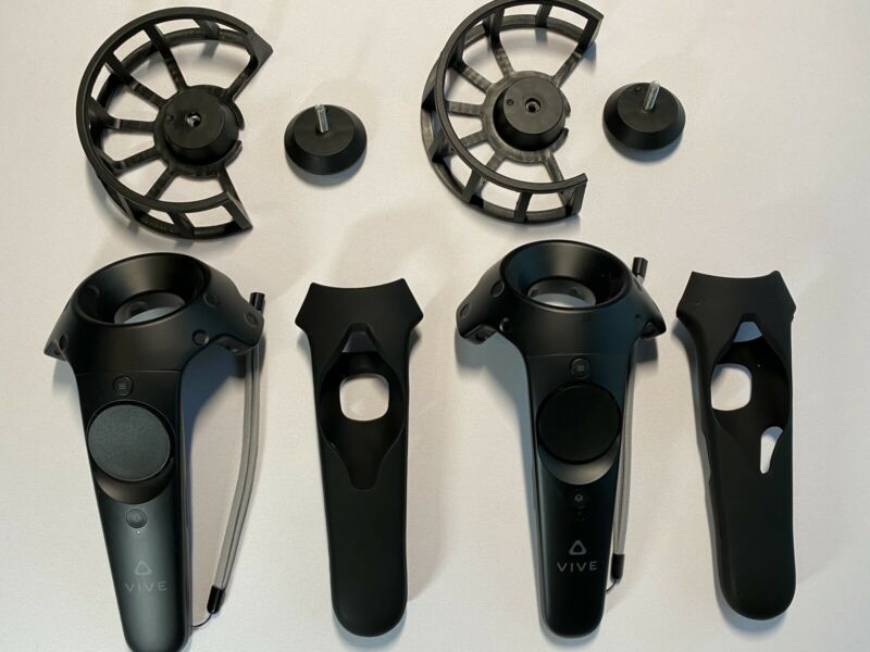 HTC Vive Controllers With Protective Rubber Sleeves And Impact Protectors.