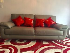 Grey leather infinity sofa new condition , negotiable