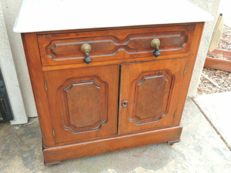 American Victorian Walnut Commode Marble Top Antique brass casters Local Pickup