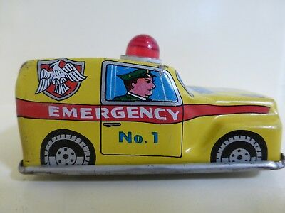 SET OF 2 1950'S  WIND UP MINIATURE TOYS----TRAIN AND EMERGENCY CAR GOOD COND.