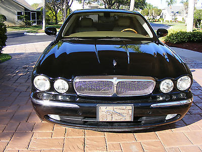 many cars aspire to greatness this jaguar xj8 actually delivers greatness certified pre. Black Bedroom Furniture Sets. Home Design Ideas