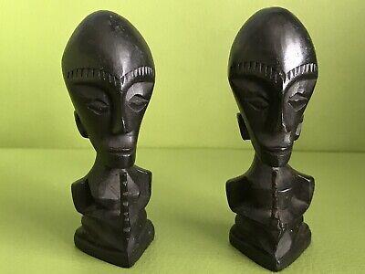 Pair of Indonesian dark hardwood carvings of people