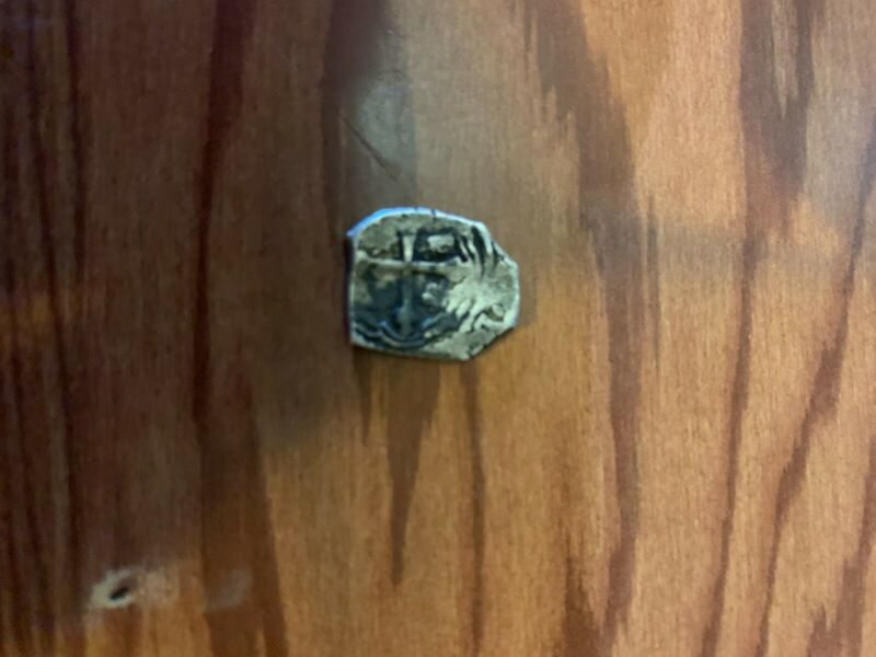 Artifact 2 Reales silver coin from 1715 shipwreck Mel Fisher