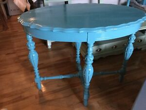 Bright blue antique table —**