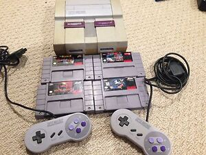 Super Nintendo with 4 games