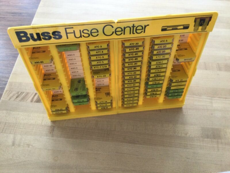 Yellow plastic Buss Fuse Center with many fuses (pre-owned)