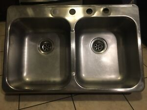 Stainless steel kitchen sink with faucet and sprayer