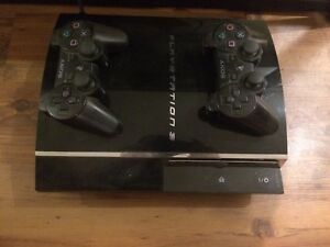 PlayStation 3 with 2 controllers + 4 games