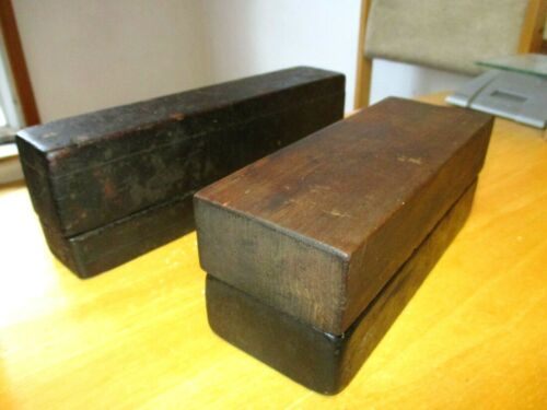 TWO VERY OLD ANTIQUE SHARPENING STONES IN COFFIN BOXES