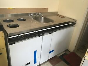 Kitchen fridge sink and oven for a apartment