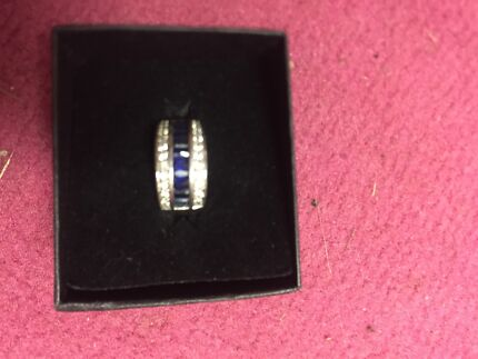 Silver ring with blue sapphire and cubic zirconia