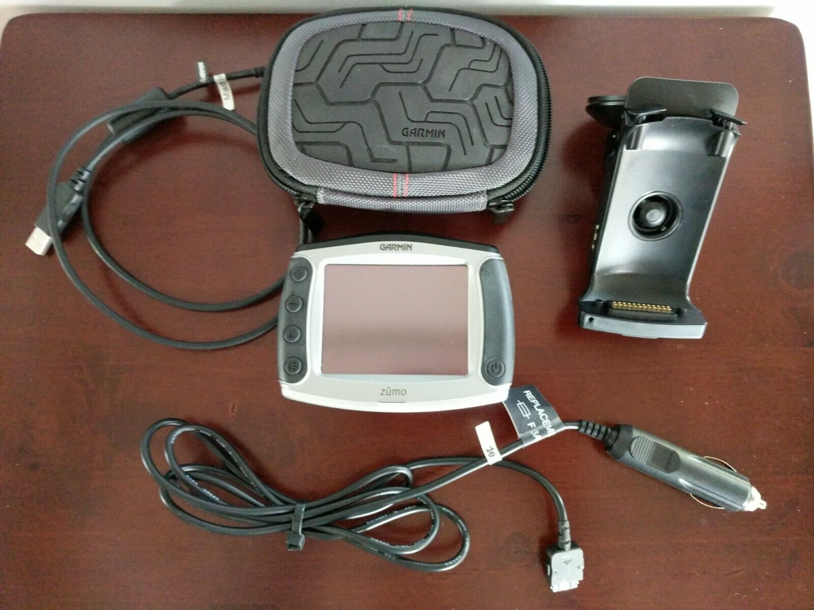Garmin Zumo 550 Car/Motorcycle GPS Navigator With Cables, Car Mount And Case - $150.00