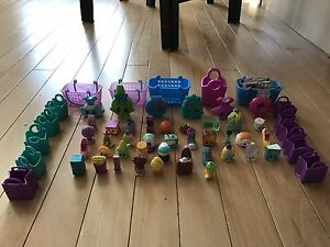 42 Shopkins and bags, collector papers