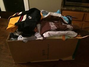 Box overflowing with boys 12 mos clothing