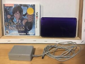 Nintendo 3ds with a game purple