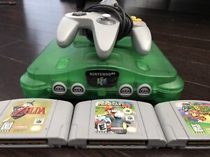 Nintendo 64 jungle green with Mario games for sale