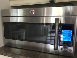 GE Microwave with vent for sale