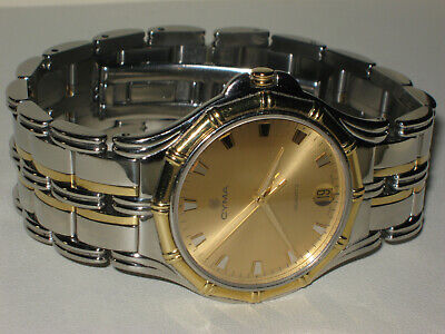 $ 1.600,- CYMA 18 K SOLID GOLD AND STAINLESS STEEL 35 mm LUXURY MENS DRESS WATCH