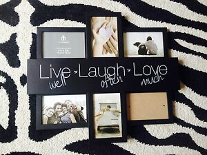 Wall Frame with 6 spots for photos $15
