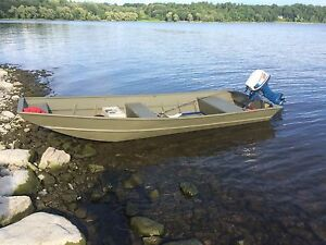 14' Prince craft johnboat and a Honda 9.9 motor and trailer