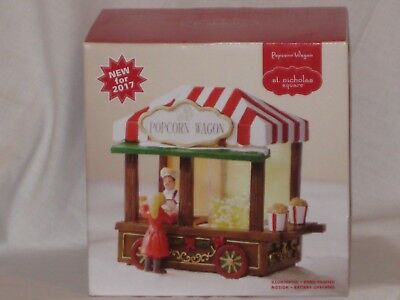 "St. Nicholas Square Illuminating and Motion ""Popcorn Wagon""   Village Collection"